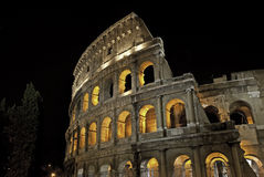 Illuminated Coliseum at night Royalty Free Stock Images