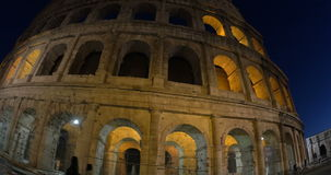 Illuminated Coliseum in Rome at night stock video footage