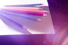 Illuminated Colored Pencils. Colored pencils in dramatic lighting Royalty Free Stock Photography