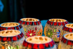 Illuminated Colorful Candle Votive. Colorful Candle Votive illuminated on the Eve of Diwali or Christmas Stock Photo