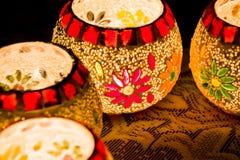 Illuminated Colorful Candle Votive. Colorful Candle Votive illuminated on the Eve of Diwali or Christmas Royalty Free Stock Photo