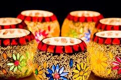 Illuminated Colorful Candle Votive. Colorful Candle Votive illuminated on the Eve of Diwali or Christmas Stock Photos