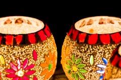 Illuminated Colorful Candle Votive. Colorful Candle Votive illuminated on the Eve of Diwali or Christmas Stock Photography