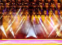 Illuminated concert stage. Illuminated empty concert stage with haze and rays of pink and yellow light. Background for music show Royalty Free Stock Photography
