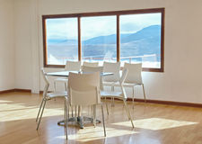 Illuminated conference room with mountain landscape Stock Photos