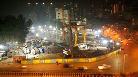 Illuminated Construction of Mumbai Subway metro. View of deep passage for entering tunnel boring machine for construction of Mumbai Metro underground section royalty free stock images