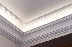 Illuminated cornice, bright interior background Stock Image
