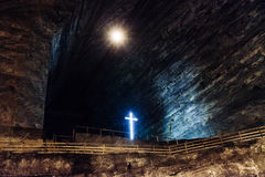 Illuminated cross at Slanic Salt mine Royalty Free Stock Photography