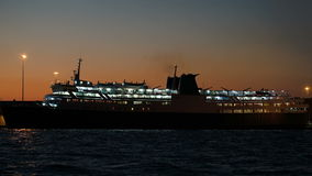 Illuminated cruise ship in late evening stock video