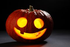 Illuminated cute halloween pumpkin Royalty Free Stock Images