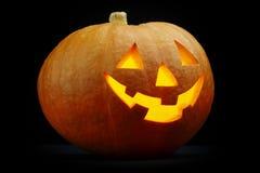 Illuminated cute halloween pumpkin Stock Photos