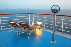 Illuminated deck-chair and binocular on ship Royalty Free Stock Photo