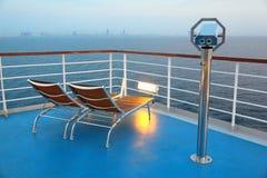 Illuminated deck-chair and binocular on ship Royalty Free Stock Photo