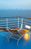 Illuminated deck-chair on ship deck Stock Images