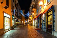 Illuminated and decorated evening street in Alba, Italy stock photos