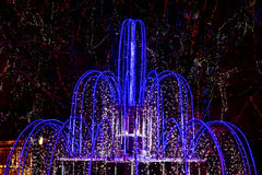 Illuminated and decorated fountain and trees in Tv Stock Photography