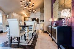 Illuminated dining room. Interior in luxury mansion Royalty Free Stock Photo