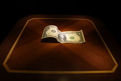 Illuminated dollar on the table Royalty Free Stock Image