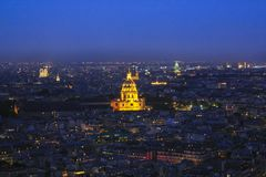 Illuminated Dome des Invalides during sunset in Paris, France stock images