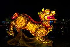 Illuminated dragon statue in Hoi An, Vietnam. stock photo