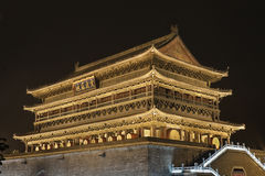 Illuminated Drum Tower at ancient city wall by night time, Xian, Shanxi Province, China Stock Image