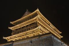 Illuminated Drum Tower at the ancient city wall at night, Xian, Shanxi Province, China. The illuminated ancient Drum Tower located at the ancient city wall by stock photo