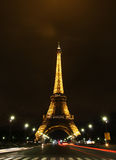 Illuminated Eiffel at night with light trails Royalty Free Stock Photo