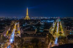 Illuminated Eiffel tower. At night seen from the Arc de Triomphe in Paris Stock Images