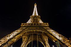 Illuminated Eiffel tower at midnight Stock Image