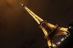 Illuminated Eiffel tower at night Stock Photo