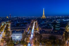 Illuminated Eiffel tower. At night seen from the Arc de Triomphe in Paris Stock Photo