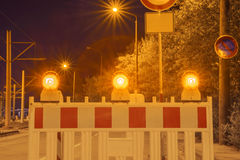 Illuminated element of the fencing of the construction site at night Royalty Free Stock Images