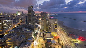 Illuminated elevated day to night view of beachfront hotels tel aviv israel stock video footage