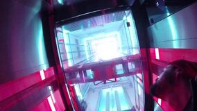 Illuminated Elevator In A`DAM Tower, Amsterdam. A`DAM Tower, Amsterdam, Netherlands Holland, 03 Nov 2017: Going Up On Illuminated Transparent Glass Elevator With stock video