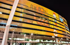 Illuminated eliptical building in vivid colors at night Royalty Free Stock Photo