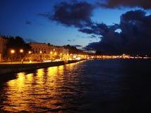 Illuminated embankment of river Neva in the summer night. Panorama quay of old St. Petersburg, Russia Stock Photos