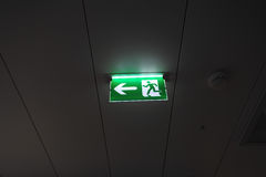 Illuminated emergency exit sign Royalty Free Stock Photos