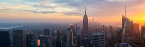 Illuminated Empire State and New York's skyline at night Royalty Free Stock Image