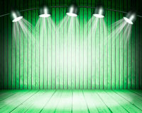 Illuminated empty concert stage. Illuminated empty green concert stage with soffits. 3D illustration Stock Photo