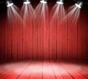 Illuminated empty concert stage. Illuminated empty red concert stage with soffits Royalty Free Stock Photo