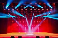 Illuminated empty theater stage Stock Photo
