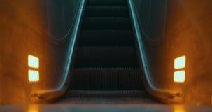 Illuminated escalator moving up stock video footage