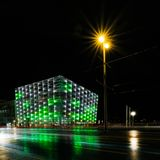 Ars electronica center Linz on a rainy night. The illuminated facade of the ars electronica center museum on a rainy night Royalty Free Stock Photos