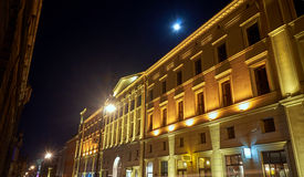 Illuminated facade of the building and moon Royalty Free Stock Images