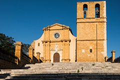 The illuminated facade of the cathedral of Agrigento. On the top of the city center royalty free stock photos
