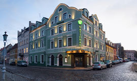 Illuminated facade of the hotel NATIONAL. Theater Square, Klaipeda city. Lithuania. Royalty Free Stock Image