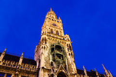 Illuminated Facade of New Town Hall in Munich Stock Photo