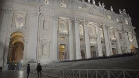Illuminated facade of St Peter's Basilica in Vatican, Renaissance architecture. Stock footage stock video footage