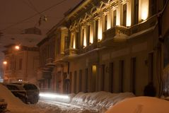 Illuminated facade in winter. Illuminated facade of an old restored building in winter Stock Images