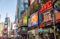 Illuminated facades of Broadway stores and theaters Stock Photos